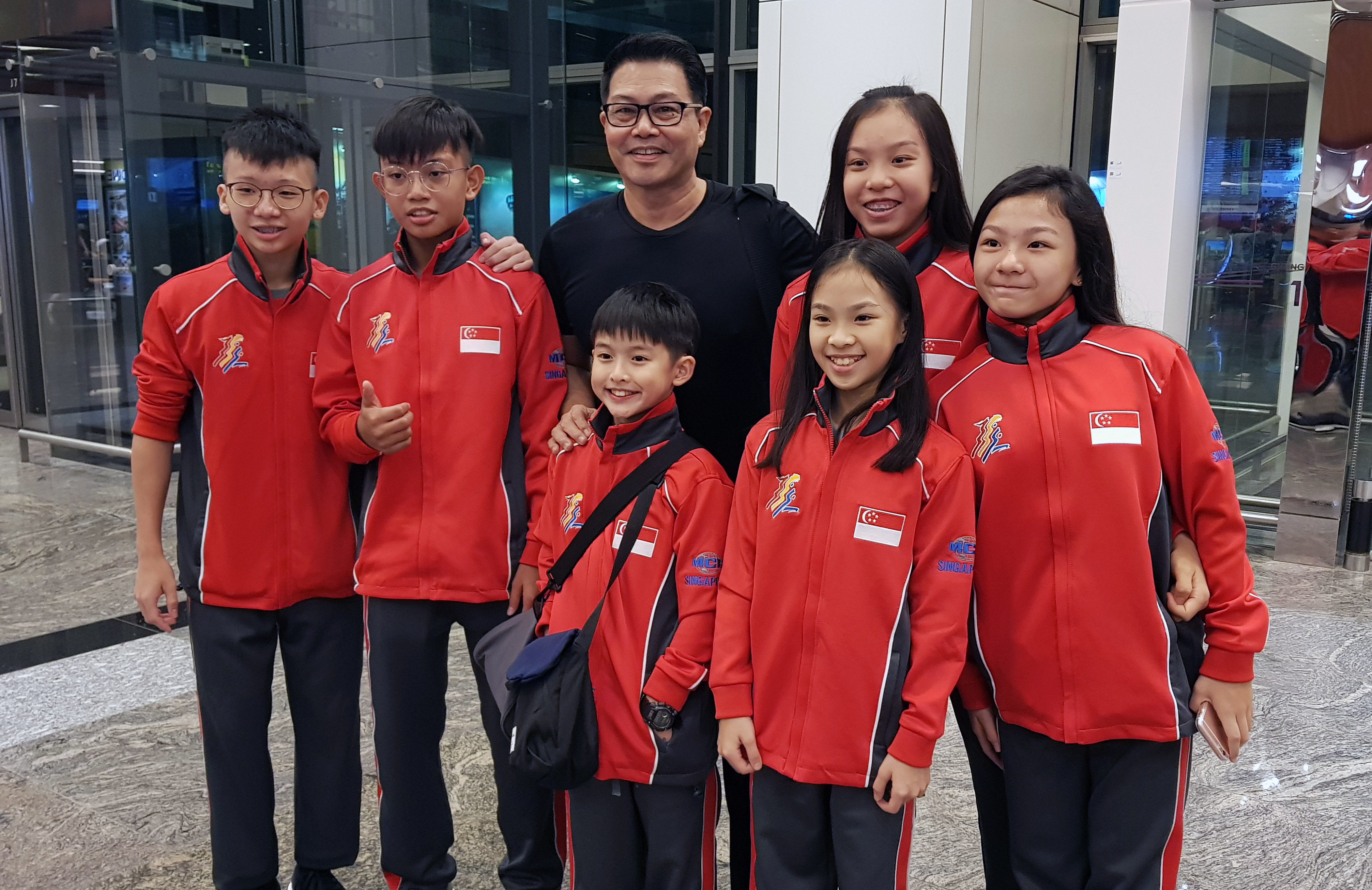 Xuan Sports athletes with Coach Winston